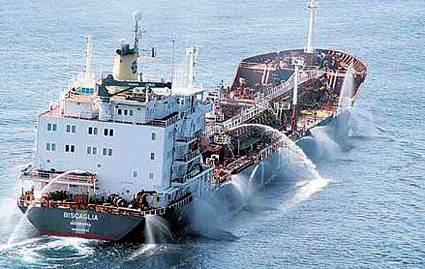 MV Bisaglia fires water cannon to try and repel invaders.