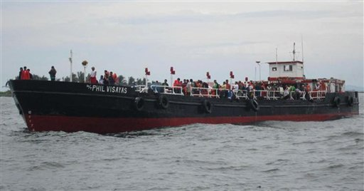 Philippine Coast Guard rescues 178 passengers from sinking ship (MV Asia Malaysia) in 2011. Photo credit: AP News & Asian Correspondent.com.
